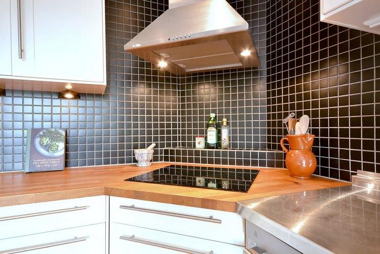 Плюсы и минусы варочной панели в углу кухни