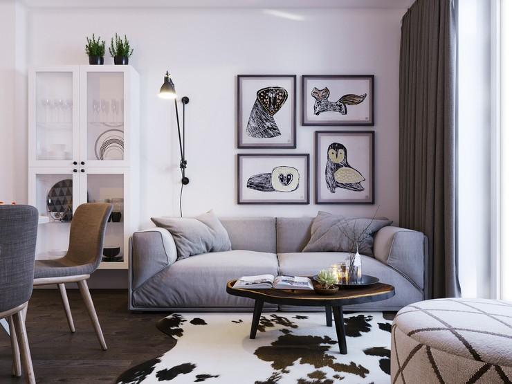 Стена над диваном украшается постерами, фотографиями и плакатами