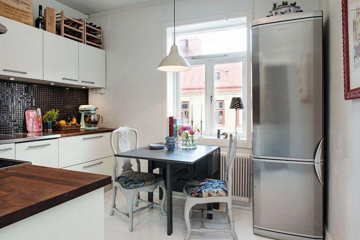 Как гармонично «вписать» холодильник в интерьер малогабаритной кухни: фото-идеи